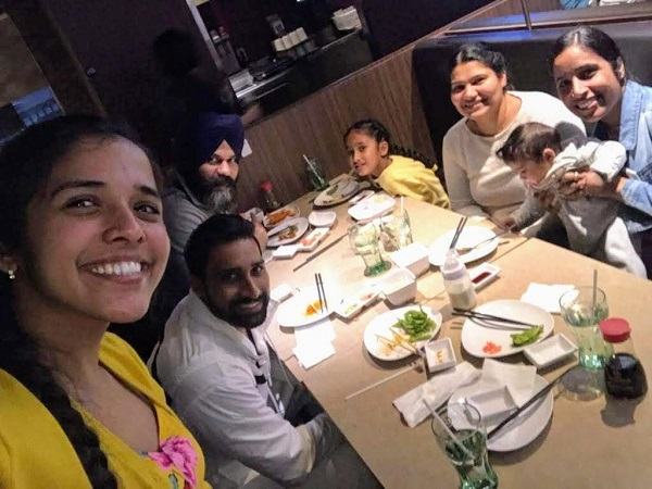 Harpreet (left front) enjoys a London, Ont., sushi dinner with her parents, her sister and brother, and her sister's children.